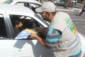Palestinians give sweets