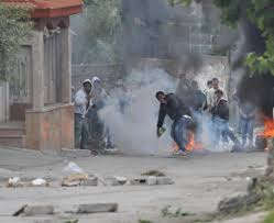 palestinian protesters (example) and tires burning