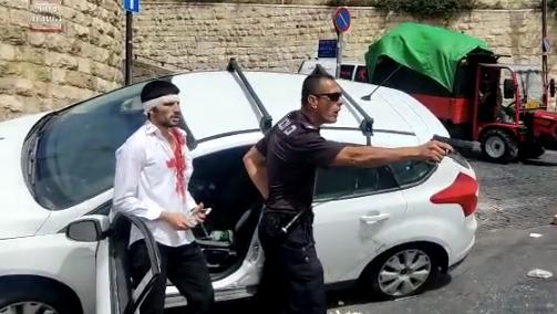 Police Protecting Injured Motorist